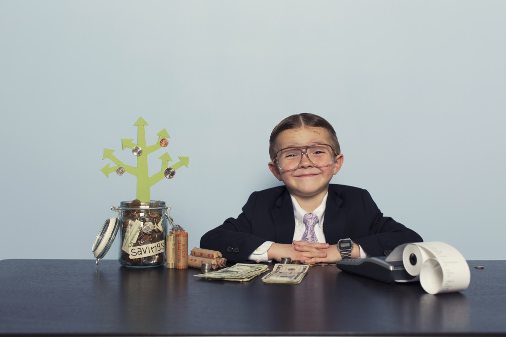 A young investor is happy with saving his money and growing his money tree.
